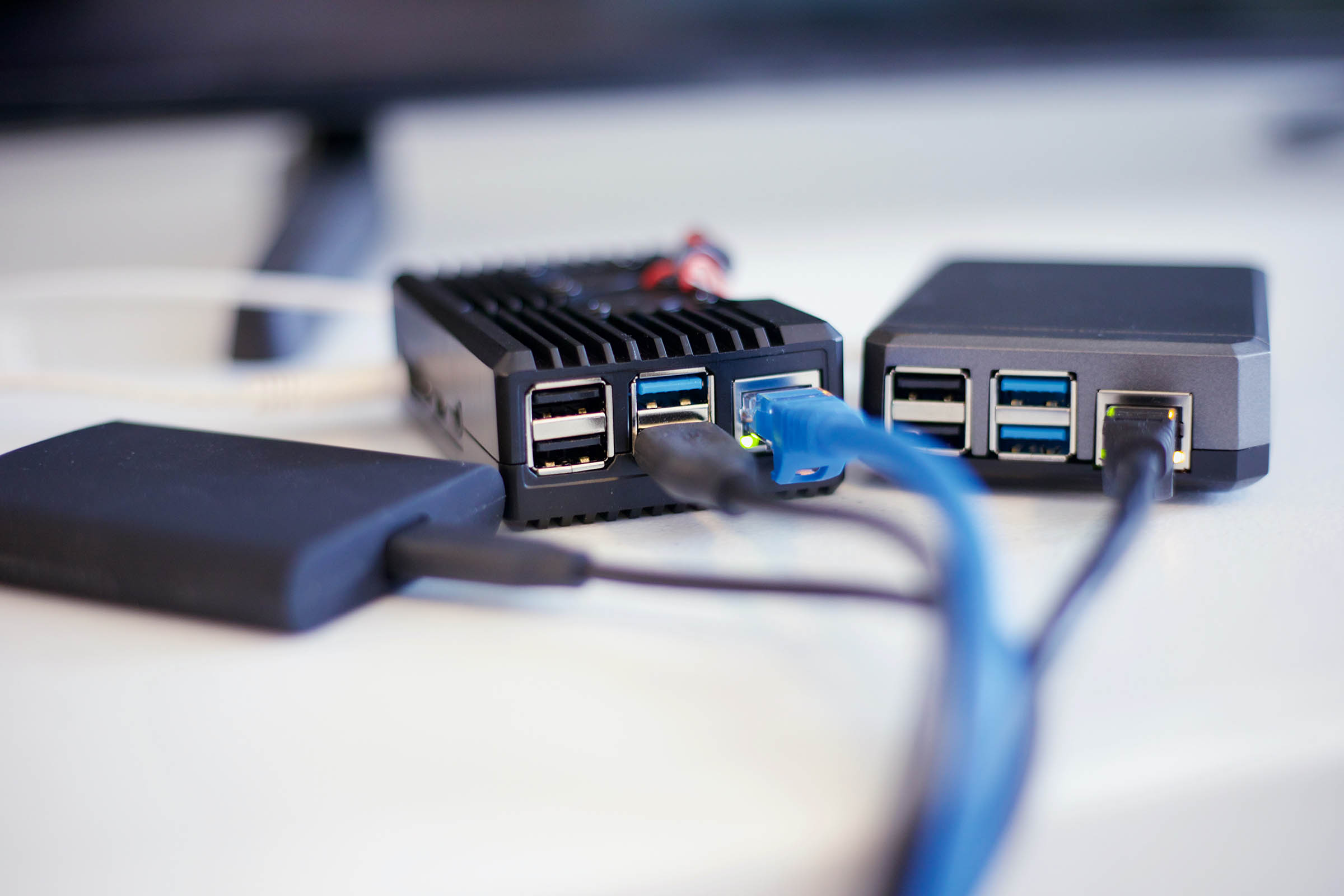usbs and ethernet cables plugged into devices