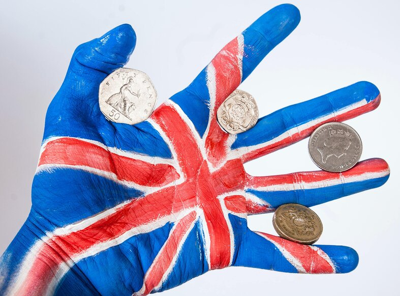 hand painted like uk flag with coins inbetween fingers